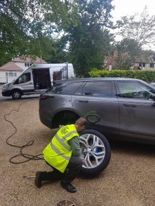 Qualified 24hr Mobile Tyres Fitting Ltd technician fits new tyre to customer SUV