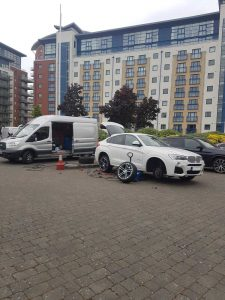 White BMW driver calls 24 hour emergency tyre fitting service to fit new front tyre
