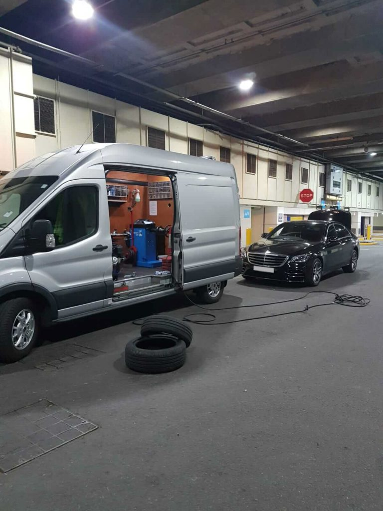 24hr Mobile Tyres on a job to fix black Mercedes car with a flat tyre