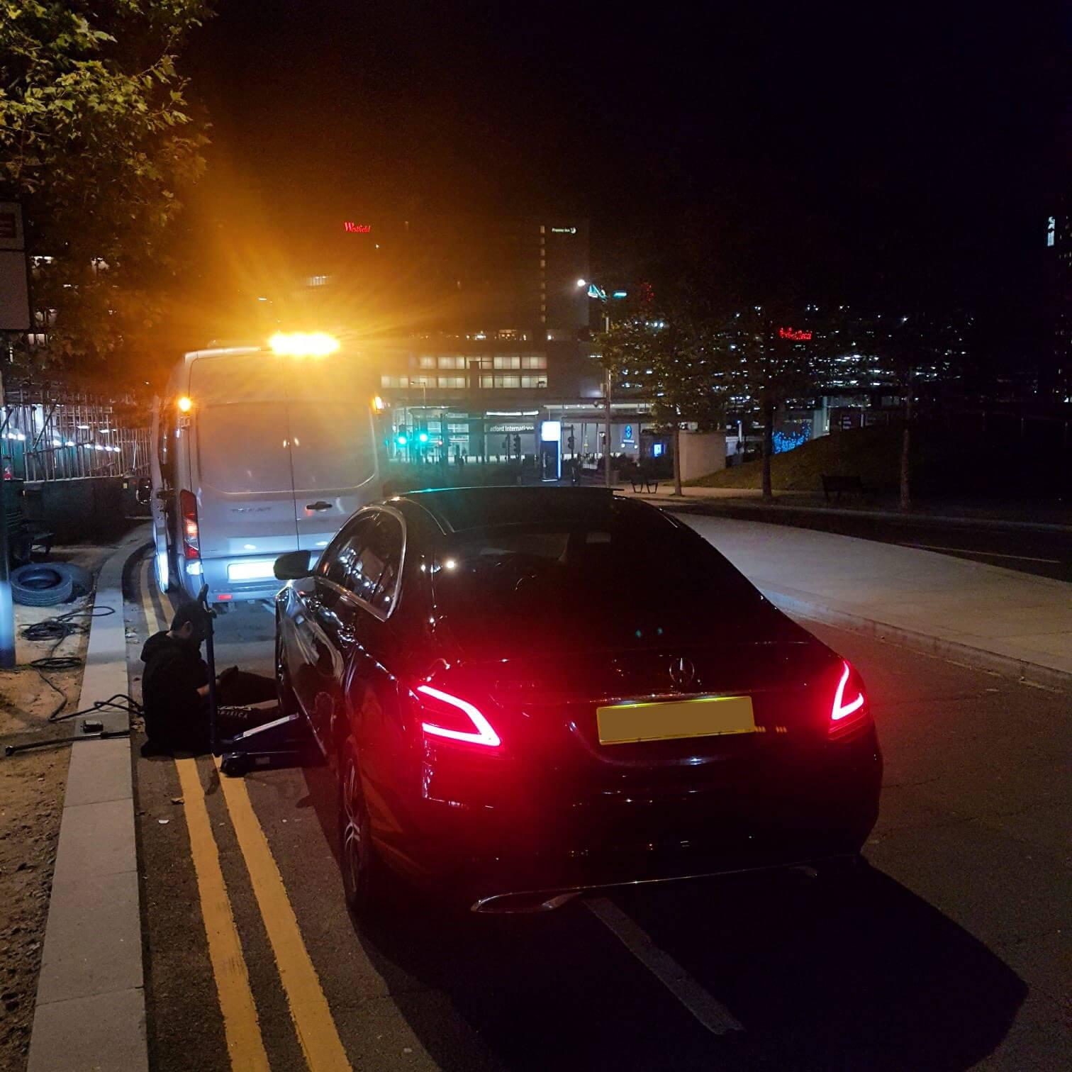 24hr mobile tyre van working late in night on customers car